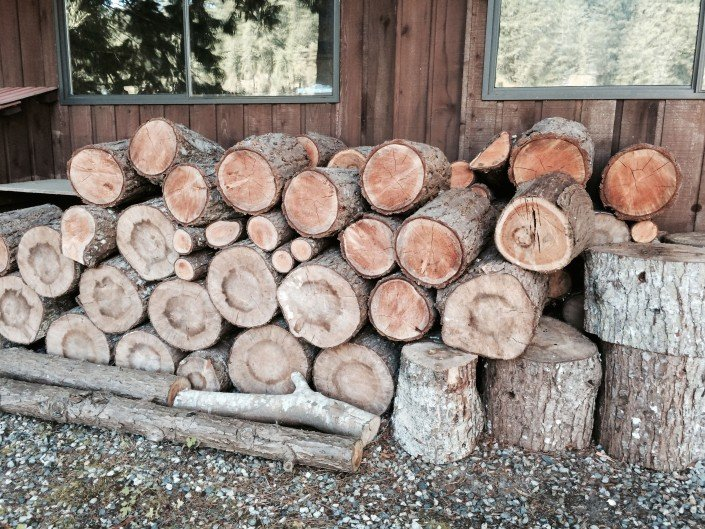 stacking firewood for winter in sechelt on the sunshine coast bc