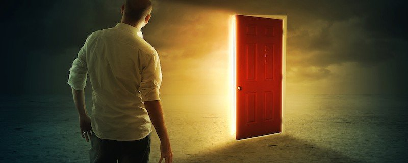 Man at the front of a Red Door
