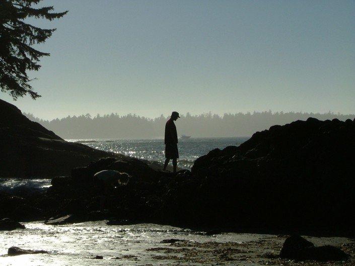 Beach combing Vancouver Island on Mackenzie beach Tofino BC