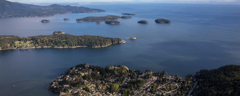 Gibsons, Keats Island, Pasley Island, and Bowen Island with Vancouver in Background. Taken in Sunshine Coast, British Columbia, Canada, from an Aerial Perspective.