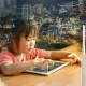 girl viewing tablet coast lifestyles network