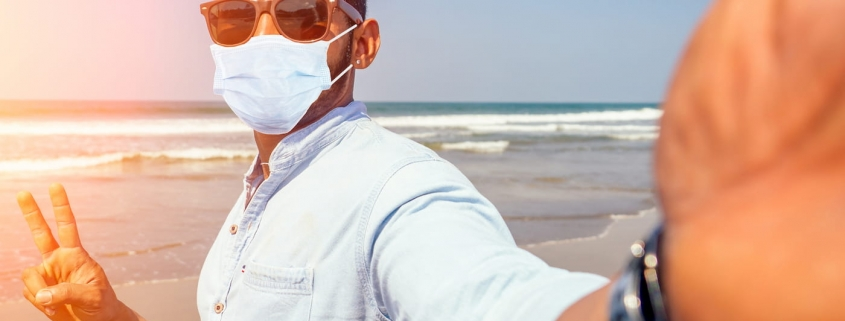 man-on-the-beach-wearing-mask-summer-web