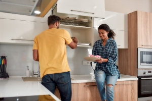 young-multicultural-couple-cleaning-house