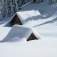 log cabin snowed in